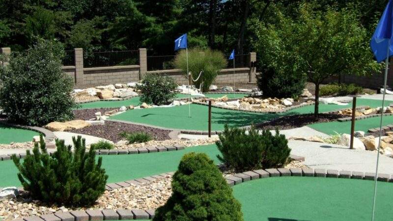 A nice looking mini golf course in Sarasota with trees and rocks and clean greens