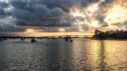 A nice sunset over Sarasota Bayfront Park with boats in the water