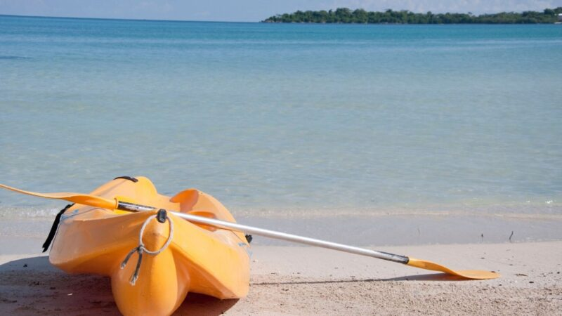 A kayak on the beach ready to be enjoyed near our Sarasota vacation rentals